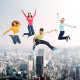 Group of smiling teenagers jumping in air Stock Image