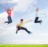 Group of smiling teenagers jumping in air Royalty Free Stock Photos