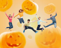 Group of smiling teenagers jumping in air Royalty Free Stock Photography