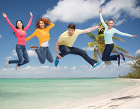 Group of smiling teenagers jumping in air Stock Photo