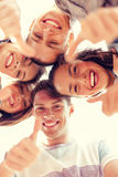 Group of smiling teenagers looking down Royalty Free Stock Image