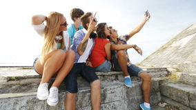 Group of smiling teenagers making selfie outdoors stock video