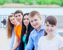 Group of smiling teenagers outdoors Stock Photo