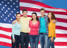 Group of smiling teenagers over american flag Stock Photography
