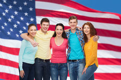 Group of smiling teenagers over american flag Royalty Free Stock Photos