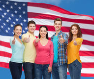 Group of smiling teenagers over american flag Royalty Free Stock Photography