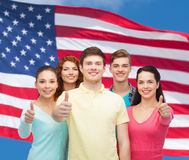 Group of smiling teenagers over american flag Royalty Free Stock Photo