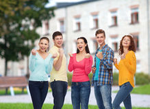 Group of smiling teenagers over campus background Royalty Free Stock Images