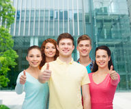 Group of smiling teenagers over city background Stock Images