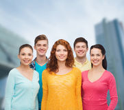Group of smiling teenagers over city background Stock Photo