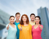 Group of smiling teenagers over city background Royalty Free Stock Photos