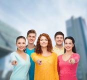 Group of smiling teenagers over city background Stock Photography