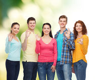 Group of smiling teenagers over green background Stock Photos
