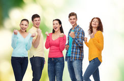Group of smiling teenagers over green background Royalty Free Stock Photography