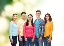 Group of smiling teenagers over green background Royalty Free Stock Photo