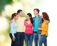 Group of smiling teenagers over green background Stock Image