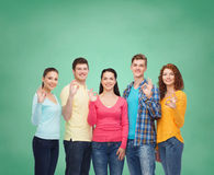Group of smiling teenagers over green board Royalty Free Stock Photo