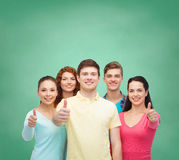 Group of smiling teenagers over green board Stock Photography