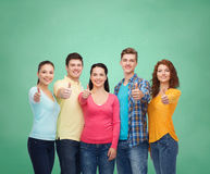Group of smiling teenagers over green board Stock Photo