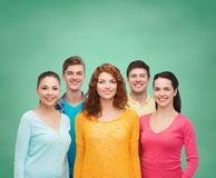 Group of smiling teenagers over green board Royalty Free Stock Photos