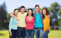Group of smiling teenagers over green park Stock Photo