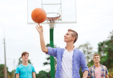 Group of smiling teenagers playing basketball Royalty Free Stock Photo