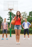 Group of smiling teenagers playing basketball Royalty Free Stock Photos