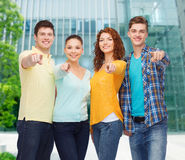 Group of smiling teenagers pointing fingers on you Stock Photo
