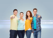 Group of smiling teenagers pointing fingers on you Stock Image