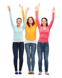 Group of smiling teenagers with raised hands Royalty Free Stock Image