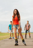 Group of smiling teenagers with roller-skates Royalty Free Stock Photos