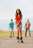Group of smiling teenagers with roller-skates Royalty Free Stock Images