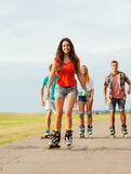 Group of smiling teenagers with roller-skates Stock Photos