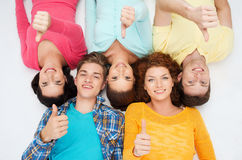 Group of smiling teenagers showing thumbs up Royalty Free Stock Photos