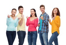 Group of smiling teenagers showing triumph gesture Royalty Free Stock Image