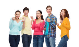 Group of smiling teenagers showing triumph gesture Royalty Free Stock Photos