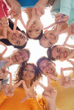 Group of smiling teenagers showing victory sign. Friendship, youth, gesture and people - group of smiling teenagers in circle showing victory sign Stock Photos