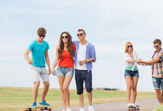 Group of smiling teenagers with skateboards Royalty Free Stock Image