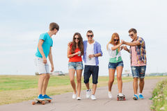 Group of smiling teenagers with skateboards Stock Image