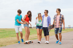 Group of smiling teenagers with skateboards Royalty Free Stock Photography