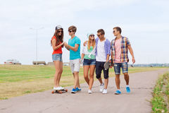 Group of smiling teenagers with skateboards Royalty Free Stock Images