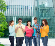 Group of smiling teenagers with smartphones Royalty Free Stock Photography