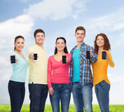 Group of smiling teenagers with smartphones Stock Photos
