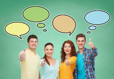 Group of smiling teenagers with text bubbles Royalty Free Stock Image