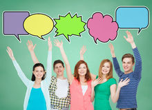 Group of smiling teenagers with text bubbles Royalty Free Stock Images