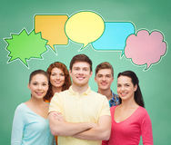 Group of smiling teenagers with text bubbles Stock Image