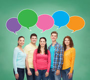 Group of smiling teenagers with text bubbles Stock Photography