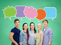 Group of smiling teenagers with text bubbles Stock Photo