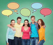 Group of smiling teenagers with text bubbles Stock Images
