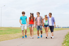 Group of smiling teenagers walking outdoors Stock Photography